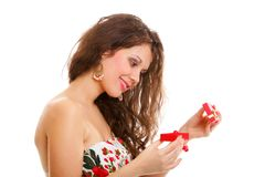 Girl opening small red gift box isolated Royalty Free Stock Photo