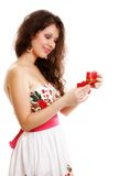 Girl opening small red gift box isolated Stock Images