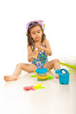Girl opening sunblock lotion royalty free stock photo