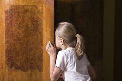Girl Opening Wardrobe Door Royalty Free Stock Image