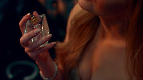 Girl opens a bottle of perfume stock footage