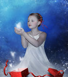Girl opens a box with  gift Stock Photos