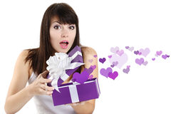 Girl opens a box surprise of hearts Royalty Free Stock Images