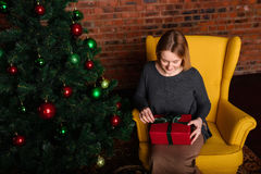 The girl opens a Christmas gift Royalty Free Stock Photo