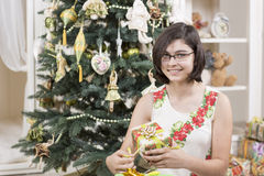 Girl opens Christmas gift Stock Photography