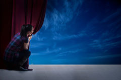 Girl opens the curtain and entrance in the magical world of nat Stock Photography
