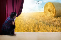 Girl opens the curtain and entrance in the magical world of natu Stock Images