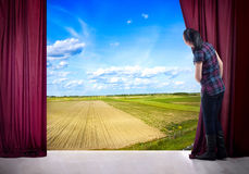 Girl opens the curtain and entrance in the magical world of natu Royalty Free Stock Photos