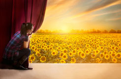 Girl opens the curtain and entrance in the magical world of natu Stock Photos