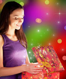 The girl opens the gift Royalty Free Stock Image