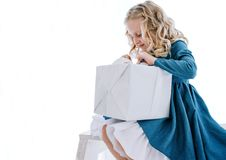 The girl opens the gift box. On a white background royalty free stock photo