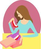 Girl opens gift box with red shoes Stock Images