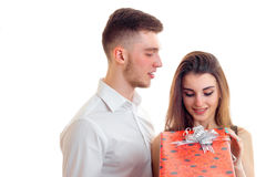 Girl opens a gift from her boyfriend Royalty Free Stock Images
