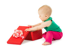 The girl opens a gift Royalty Free Stock Photos