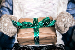 Girl opens gift Royalty Free Stock Images