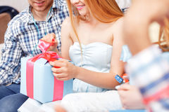 Girl opens her birthday present Stock Images