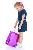 The girl opens the package purchases Stock Photography