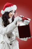 Girl opens a presents with miracle light Stock Images
