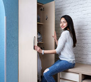 Girl opens the wardrobe Royalty Free Stock Photo
