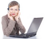 Girl the operator. In headphones with a microphone Stock Photography