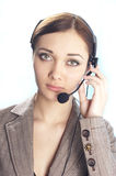 Girl operator. Girl the operator with beautiful eyes Royalty Free Stock Photo