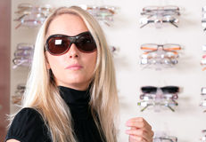 The girl in the optical salon Royalty Free Stock Photography