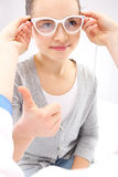 The girl in the optical salon. Royalty Free Stock Images