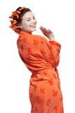 Girl in orange royalty free stock photography