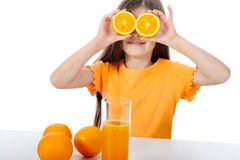 Girl with orange Stock Image