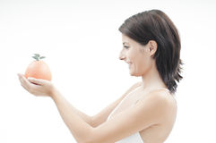 Girl with orange Stock Photos