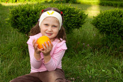 Girl & orange Royalty Free Stock Photography