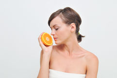 Girl with orange. Stock Photos