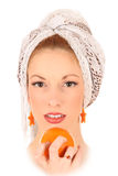 Girl with an orange Royalty Free Stock Photos