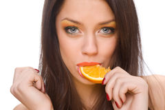 Girl and an orange Royalty Free Stock Photo