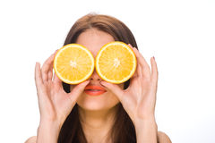 Girl and an orange Stock Photos