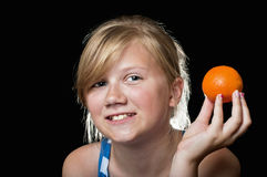 Girl with orange Royalty Free Stock Photography