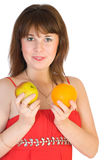 Girl with orange and apple in hands Royalty Free Stock Photo