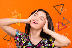 Girl on orange background with colorful triangles, sea set Royalty Free Stock Photo