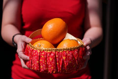 Girl With Orange basket for Chinese New Year Gifts Stock Photography