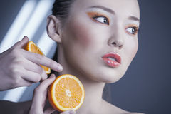 Girl with Orange Royalty Free Stock Photos