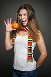 Girl with orange Royalty Free Stock Images