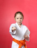 Girl with an orange belt is hitting right hand Stock Photography