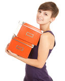 Girl with orange boxes Royalty Free Stock Image