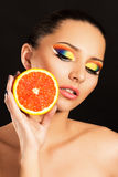 Girl with orange. Bright makeup. Girl with orange Royalty Free Stock Image