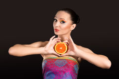Girl with orange. Bright makeup. Girl with orange Royalty Free Stock Photography