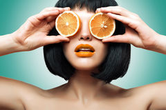Girl with orange. Bright makeup, Ombre. Beautiful girl with oranges. Bright makeup. Ombre Lips. Lipstick Royalty Free Stock Photos