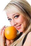 The  girl with an orange close up. The young girl with an orange close up Royalty Free Stock Photos