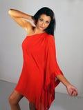 Girl in orange dress. Fashion shoot of beautiful girl in orange dress stock photo