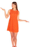 Girl in orange dress on background Stock Images