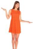Girl in orange dress on background Stock Photo